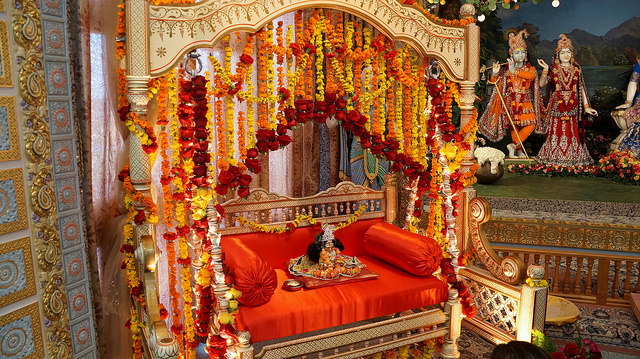 Bal Gopal sitting in a fragrant flower decorated swing