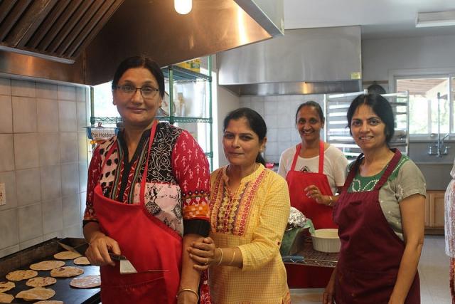 Ashram volunteer cooks prepare prashad for all