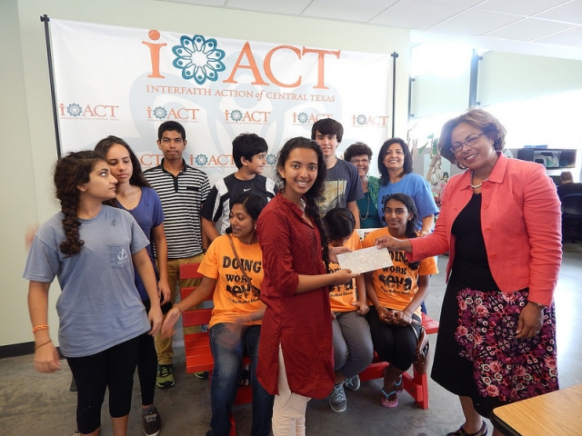 Temple youth presenting check to IACT, Austin's Interfaith organization