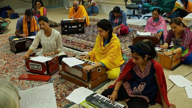 Learning the basics of harmonium during Family Camp