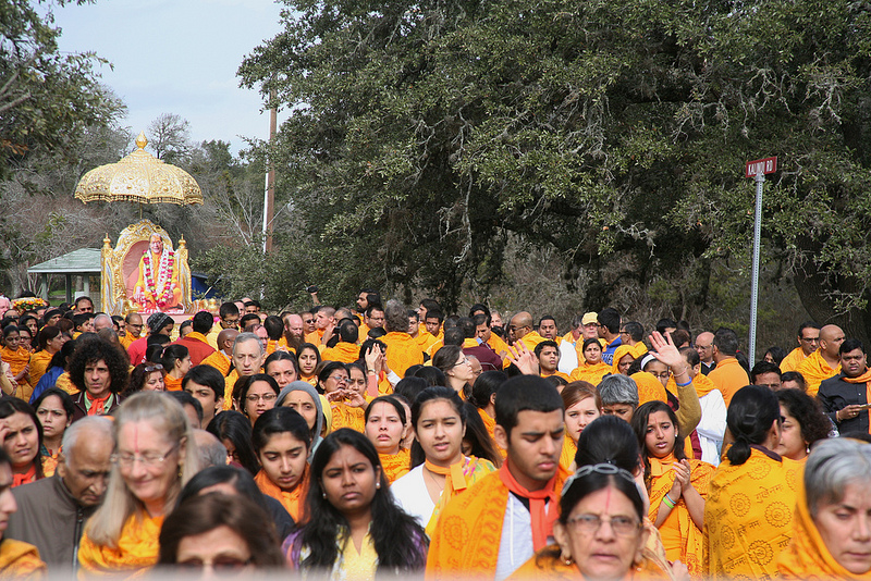 Devotees walk to the holy places of Shree Radha Mahav Dham.