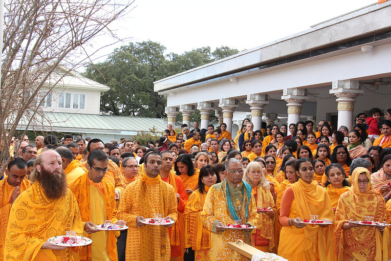 President Raj Goel & devotees perform arti before the rath.
