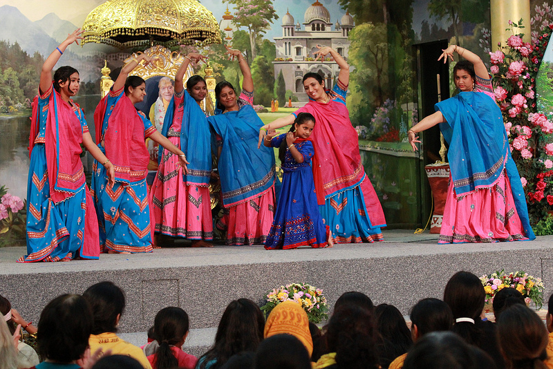 The Gopis of Radha Madhav Dham entrance the devotees during the camp's cultural program.